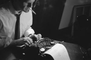 Man typing an old typewriter