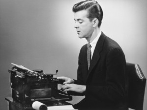 george-marks-man-sitting-at-typewriter